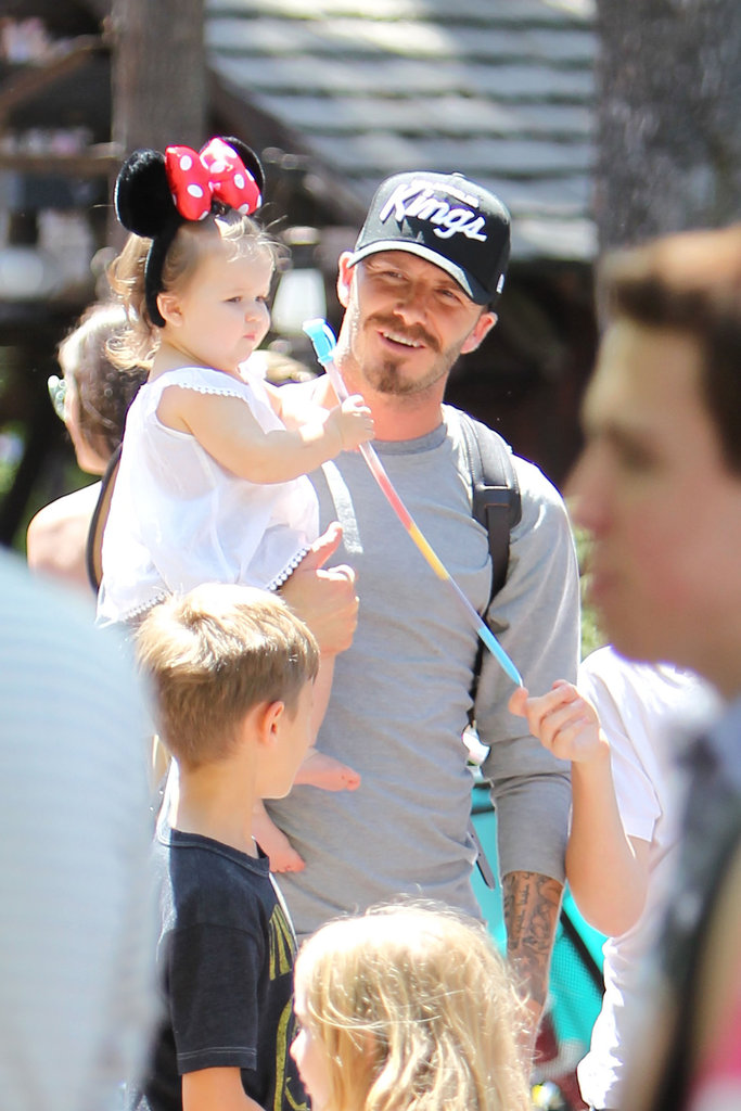 Harper Beckham wore Minnie Mouse ears while dad David Beckham carried her around Disneyland.