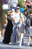 David Beckham held Harper Beckham with mom Victoria Beckham close by at Disneyland.