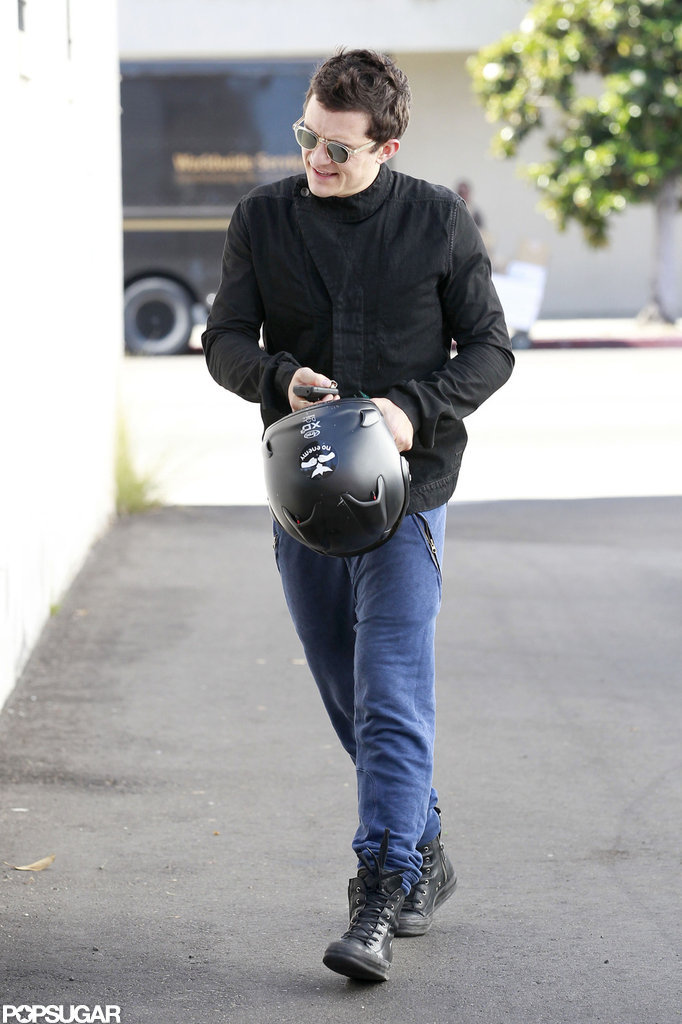 Orlando Bloom carried his helmet.