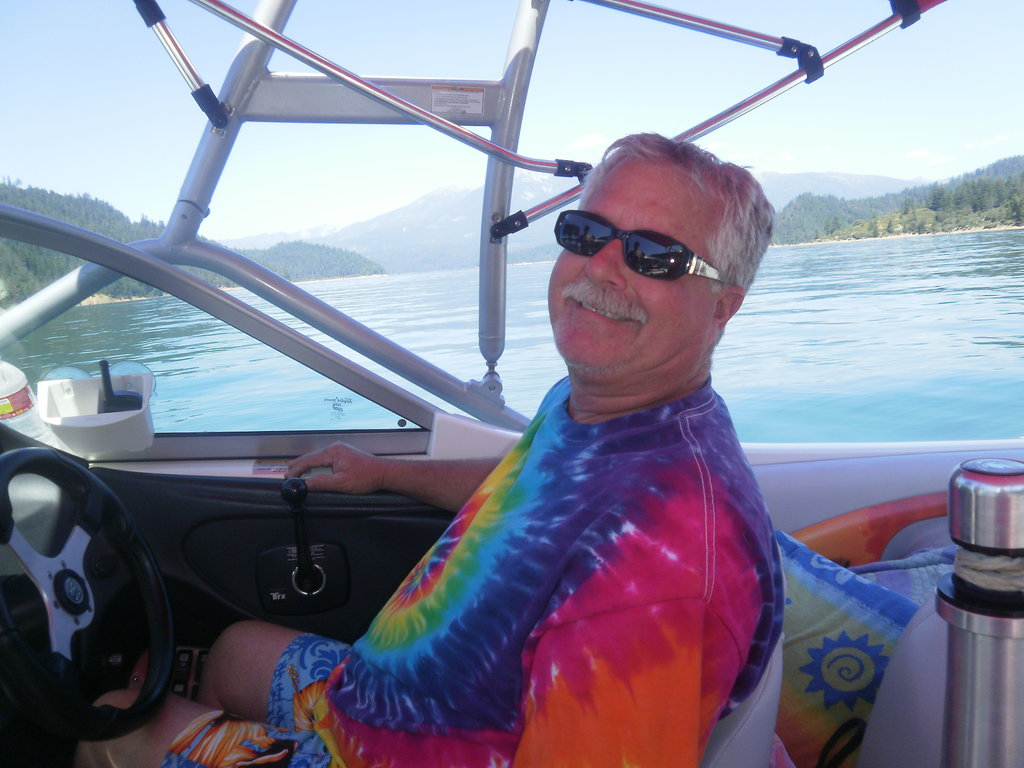 """Here's a picture of my ever-so-trendy dad, Wade. If one picture could sum him up, this would be it — tie-dye, Hawaiian-print board shorts, and the lake. That's one happy dad!"" — Kristen Cunningham, HR coordinator"