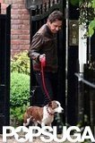Jamie Hince with Kate Moss's dog Archie.