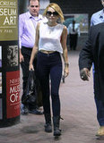 Miley Cyrus walked in New Orleans wearing boots and carrying a purse.
