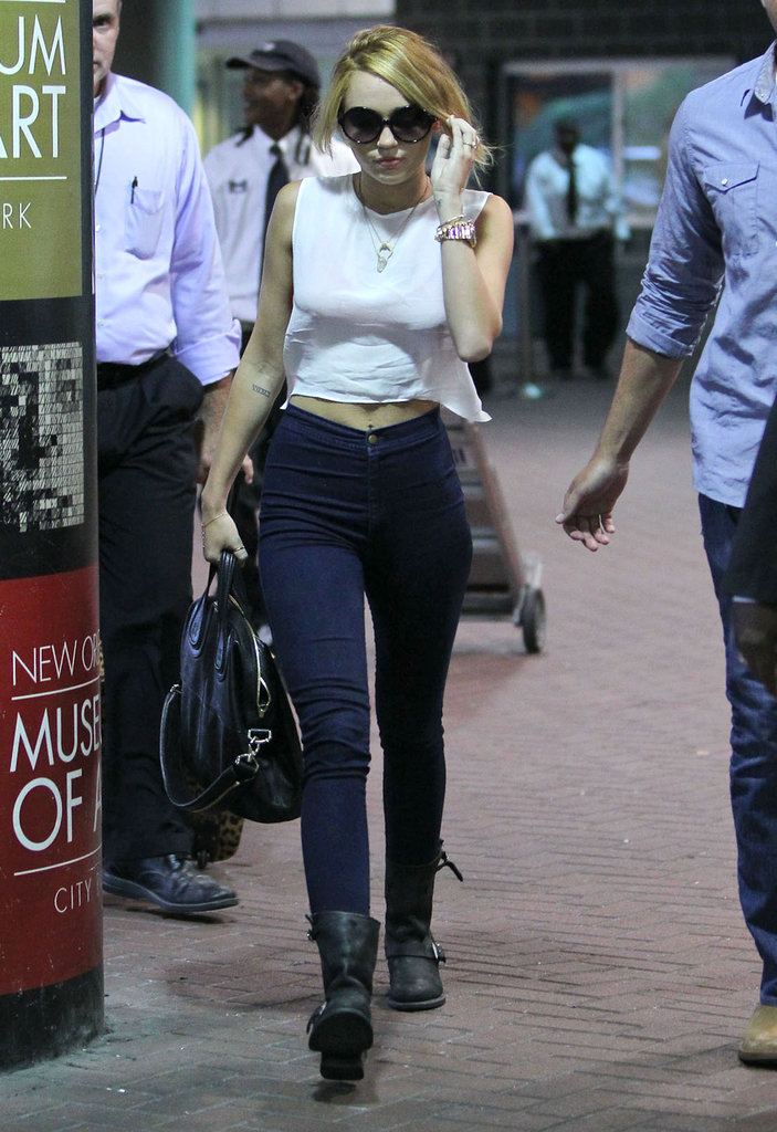 Miley Cyrus left the airport in New Orleans to visit Liam on set.