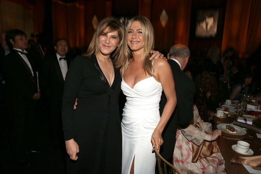 Jennifer Aniston wore Burberry and posed with a friend.