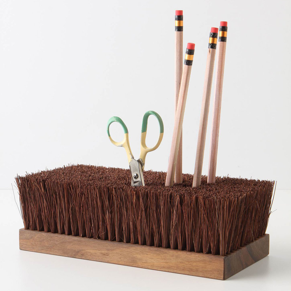 We like the old-school look of Besom Holder ($68) to keep all of Dad's office supplies at bay in an inventive way.