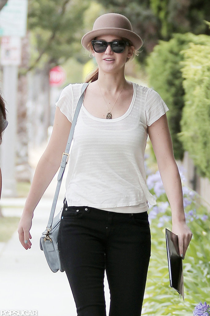 Jennifer Lawrence wore dark sunglasses.