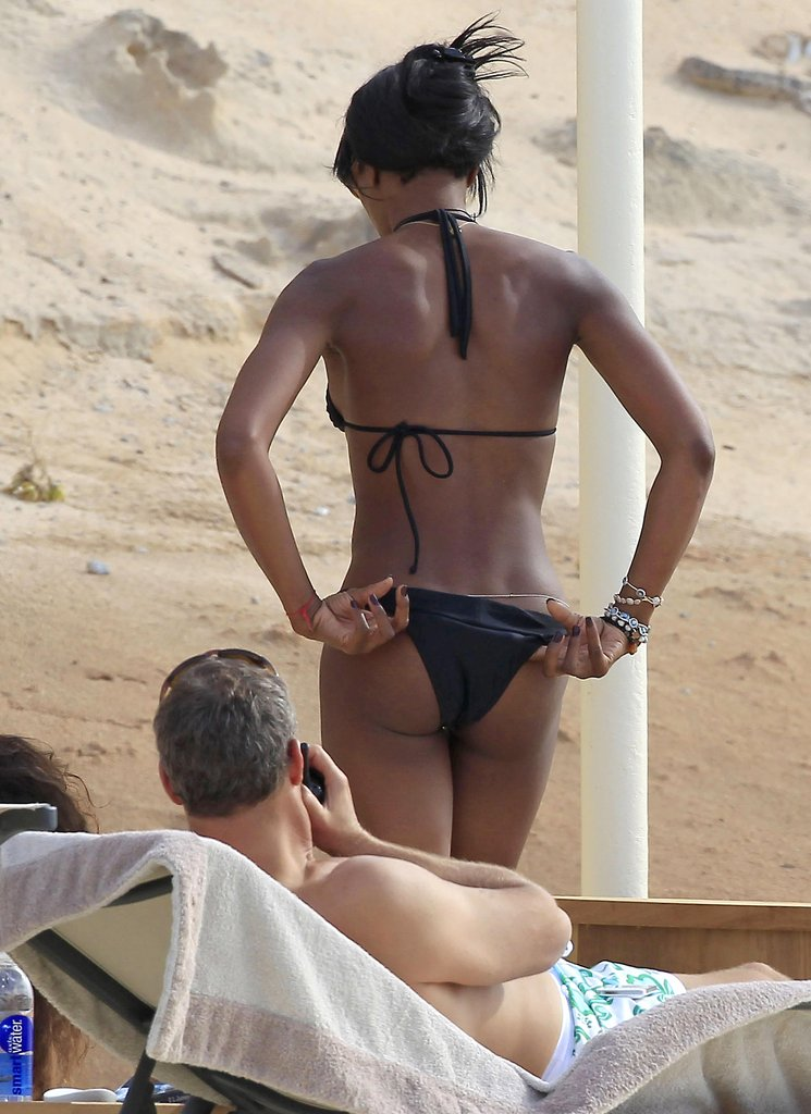 Naomi Campbell adjusted her bikini in Ibiza.
