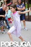Suri Cruise crossed the sidewalk in NYC.