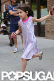 Suri Cruise sprinted for the car in NYC.