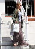 Jennifer Lawrence kept it casual in flip flops as she ran errands in LA.