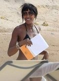Naomi Campbell smiled on the beach in Ibiza.