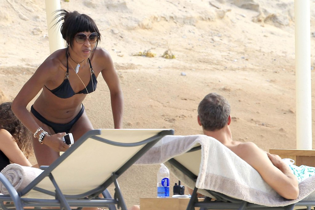Naomi Campbell donned a black bikini with friends on the beach in Ibiza.