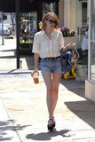 Emma Roberts illustrated the value of a great pair of Summer cutoffs — just add an equally classic white button-down and finish with walkable wedges for everyday seasonal style.