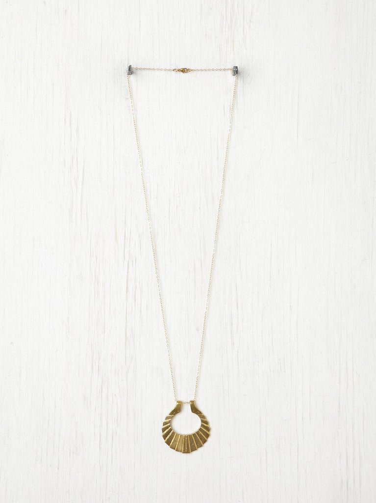 Punch up your low-key wares with a statement pendant necklace. We chose this one because the texture reminded us of a seashell. Nikki Montoya Crinkle Crescent Necklace ($263)