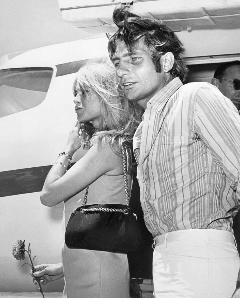 Brigitte Bardot's little shift and classic handbag would make an ultrachic combo out and about today.