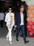 Anne Hathaway wore a white suit to the Stella McCartney presentation in NYC with Adam Shulman.