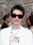 Anne Hathaway smiled at the Stella McCartney presentation in NYC.