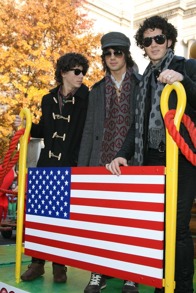 The Jonas Brothers posed behind the red, white, and blue in NYC in November 2007.