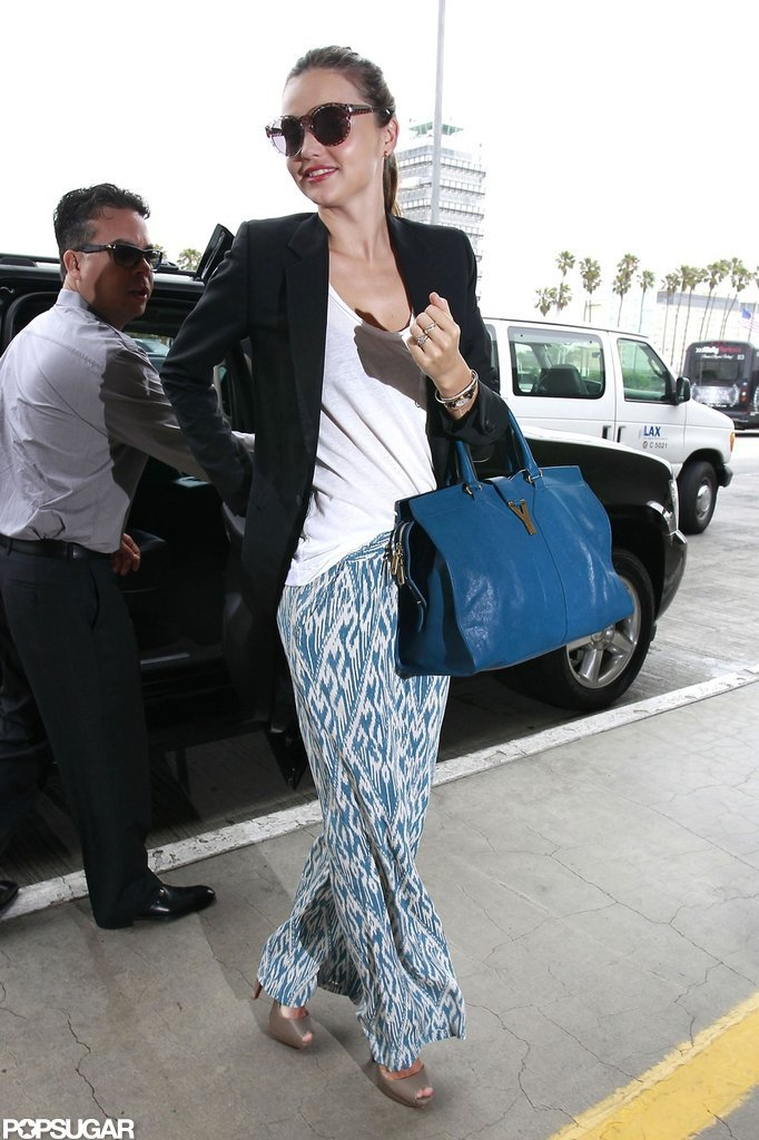 Miranda Kerr hopped out of the car to catch a flight at LAX.
