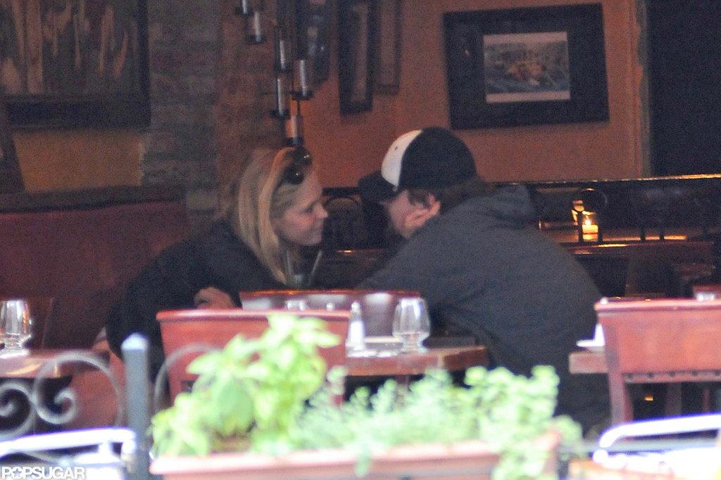 Leonardo DiCaprio and Erin Heatherton had a close conversation at Candela Candela in NYC.