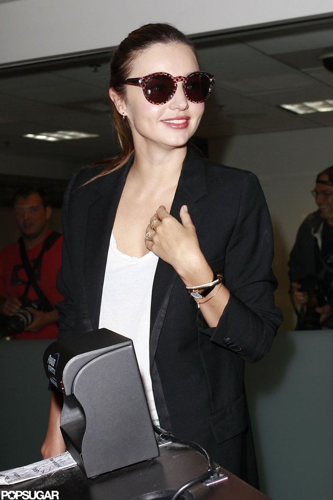 Miranda Kerr kept her sunglasses on as she walked through the airport.