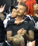 Cruz Beckham hung onto dad David Beckham at the LA Kings Stanley Cup final game in LA.