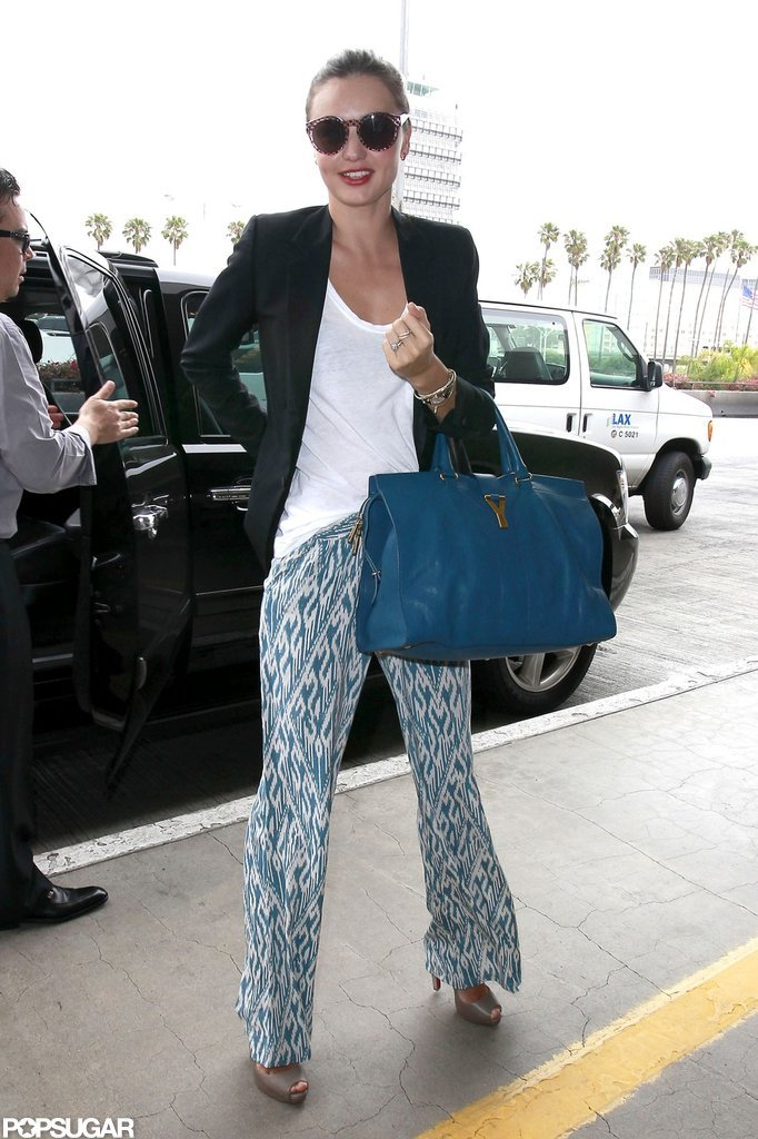 Miranda Kerr wore printed pants and a blazer as she headed to the airport.