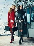 Caroline Trentini and Hilary Rhoda show off slick leather trench coats in the Bally Fall '12 campaign.
