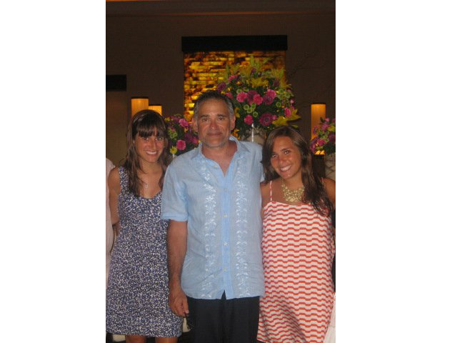 """Here's a pic of my dad channeling his inner Cuban and rocking a guayabera while on vacation in Playa del Carmen, Mexico. The two pretty ladies by his side are my sister and me."" — Stephanie Bejar, senior account manager"