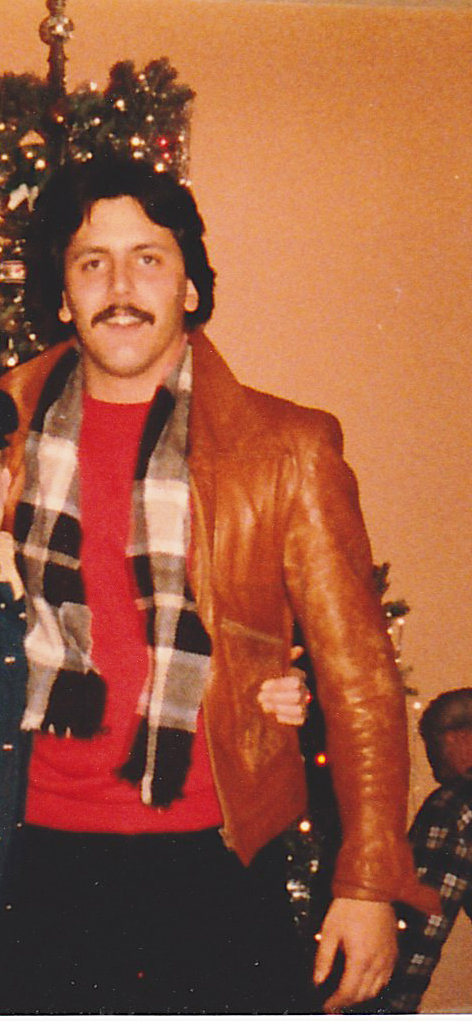 """I can't decide what I love more about my dad's style in this picture: the vintage-looking leather jacket that I wish he still owned today, or the classic '70s mustache that I am very glad he doesn't own today."" — Allison Shedlock, project manager"
