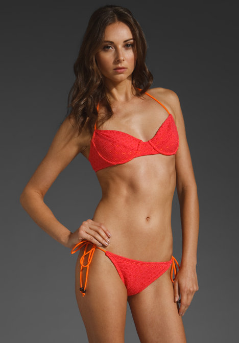 This bold, bright coral bikini will look amazing on all skin tones, and we love the contrasting side-ties. Shoshanna Crochet Bra Top ($114) and String Bottoms ($70)