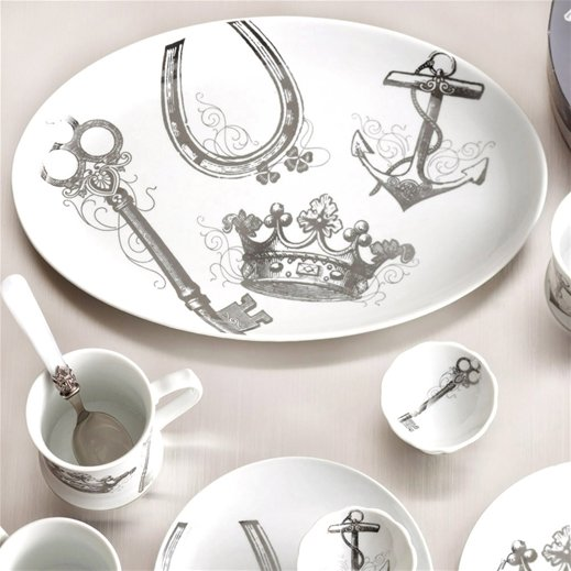 This Rosanna Table Charms Tray ($50) incorporates an anchor with other charming imagery.
