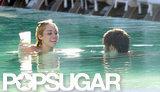 Bikini-Clad Miley Cyrus Lets Loose With a Male Companion