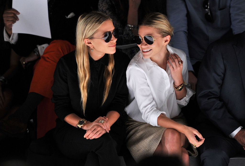 Front row professionals working it in sharp shirting and aviators.