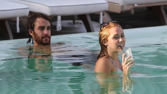Video: Miley Cyrus Responds to Backlash After Being Spotted Poolside With a Guy