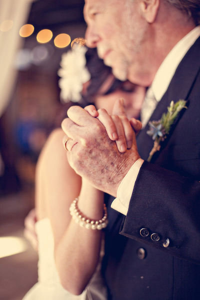 The bride and her dad got close during their dance. Photo by Three Nails via Style Me Pretty