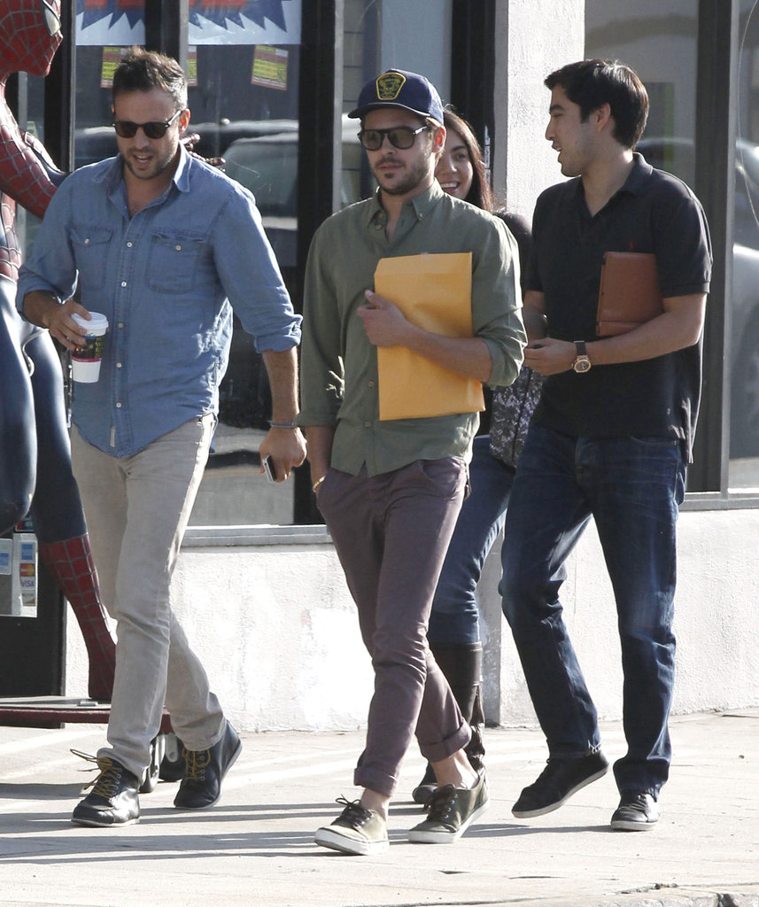 Zac Efron wore a cap and carried a script out of a meeting in LA.