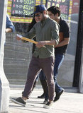 Zac Efron took a look at a script after leaving a meeting in LA.