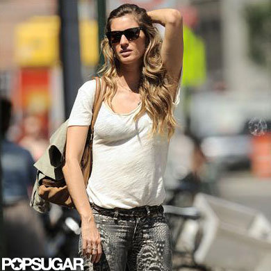 Gisele Bundchen wore a white shirt.