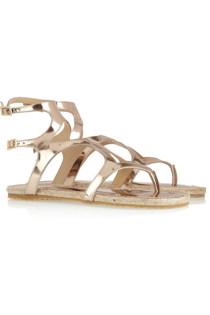 We love everything about these gladiator-style espadrilles in a near rose-gold finish that'll look great with a tan.  Jimmy Choo Peachy Metallic Leather Gladiator Sandals ($375)