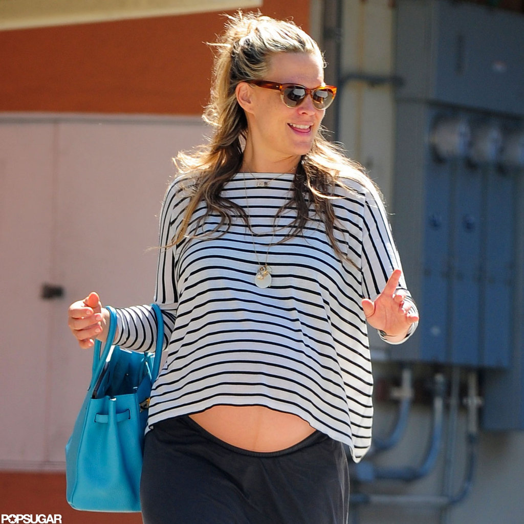 Molly Sims showed off her pregnant belly.
