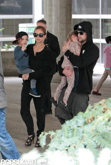 Nicole Richie, Joel Madden, Harlow Madden, and Sparrow Madden made their way through the airport.