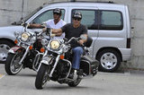 George Clooney rode his motorcycle with a friend.