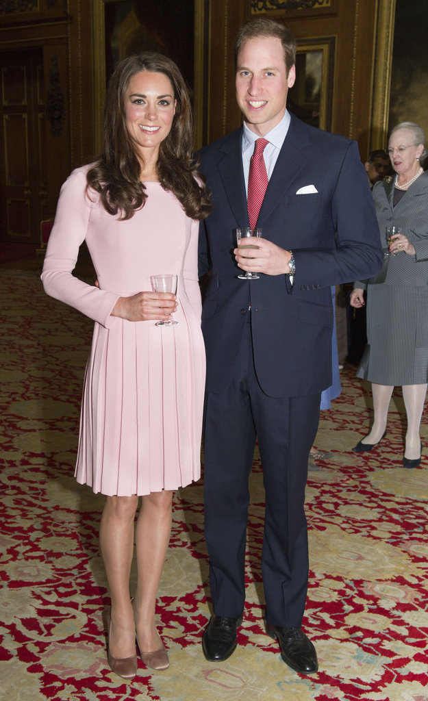The royal couple: Kate looked easy and elegant in a petal-pink, pleated Emilia Wickstead dress (which she's worn on more than one occasion!) with Prince William at her side.