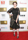 Emily Deschanel slipped into a ladylike black dress finished with lacy paneling.
