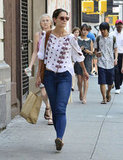 Katie Holmes walked in NYC after picking up groceries.