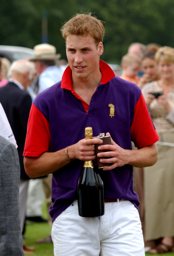 Prince William celebrated with Champagne after a charity polo match in July 2002.