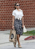 Eva Mendes can't stay away from sweet floral prints. This time, she paired a crisp white tie-front blouse from Express with a vintage daisy-accented skirt and her Christian Louboutin wedges.