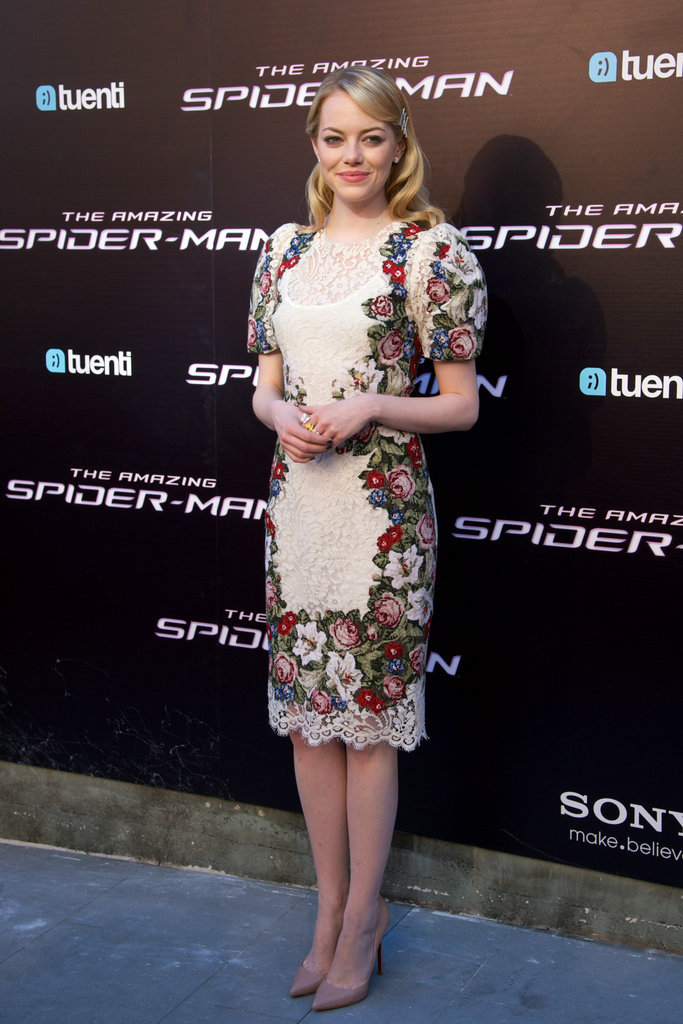 For the Madrid premiere, Emma indulged in a cool floral-embroidered puff-sleeve Dolce & Gabbana sheath. Since the dress provides quite the patterned kick, the starlet kept her hair, makeup, and accessorizing low-key.