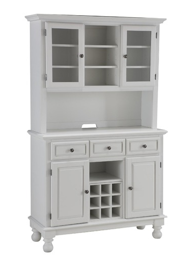 Use the top of this Hutch and Buffet ($775) to display decorative pieces, from tabletop decor to barware, and the lower cabinets to store more unsightly housewares and bottles of wine.